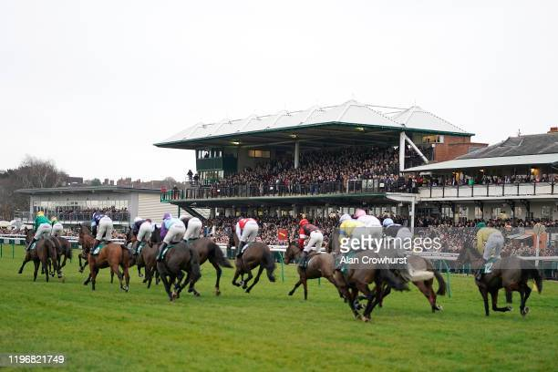 General view as runners pass a packed grandstand at Warwick Racecourse on December 31, 2019 in Warwick, England.