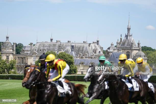 A general view as runners pass The Chateau de Chantilly during the Prix du Jockey Club meeting at Hippodrome de Chantilly on June 3 2018 in Chantilly...