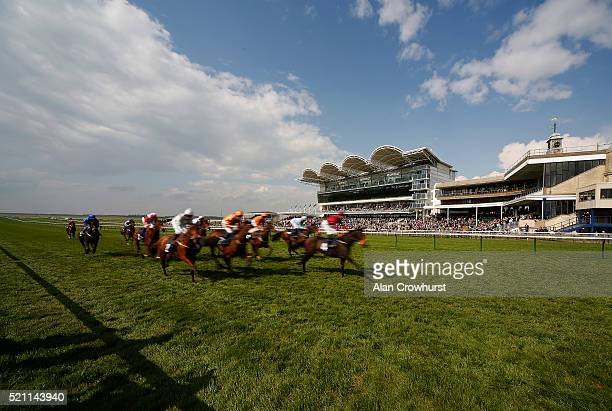 A general view as runners pass the grandstand and finish at Newmarket racecourse on April 14 2016 in Newmarket England