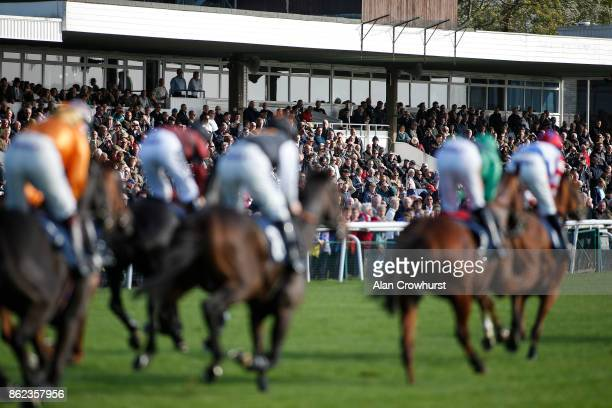 A general view as runners pass the grandstand at Huntingdon racecourse on October 17 2017 in Huntingdon United Kingdom