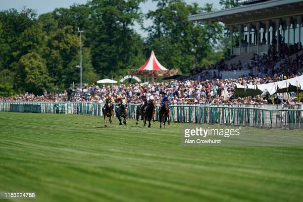 General view as runners pass the grandstand during The Qipco Prix du Jockey Club meeting at Hippodrome de Chantilly on June 02, 2019 in Chantilly,...