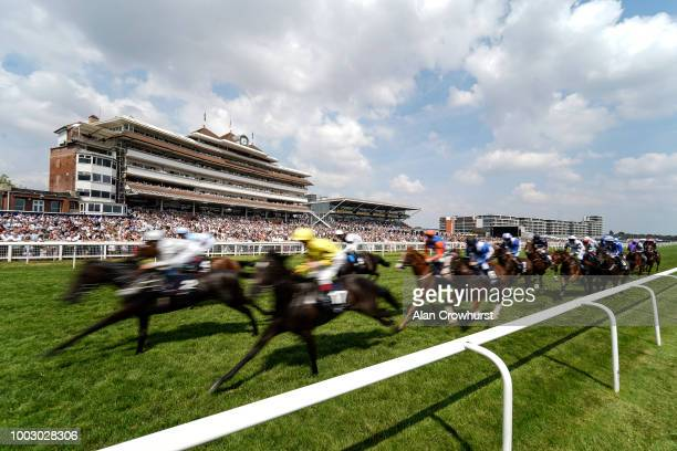 A general view as runners pass the grandstands in The JLT Cup at Newbury Racecourse on July 21 2018 in Newbury United Kingdom
