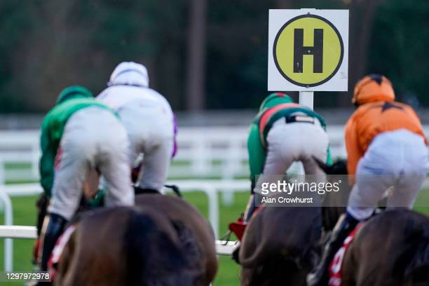 General view as runners pass the 'H' sign for the hurdle course at Ascot Racecourse on January 23, 2021 in Ascot, England. Due to the Coronavirus...