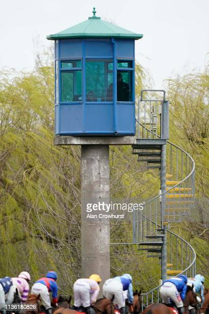 A general view as runners pass the officials tower at Kempton Park on March 16 2019 in Sunbury England