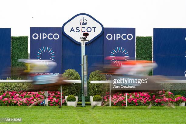 General view as runners pass the winning post on the first circuit of The John Guest Racing Brown Jack Handicap at Ascot Racecourse on July 25, 2020...
