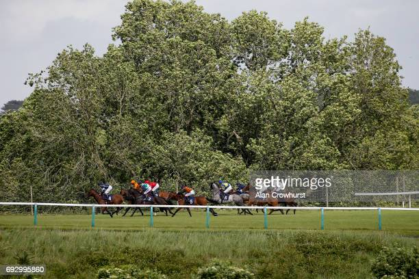 A general view as runners race down the back straight at Chepstow racecourse on June 6 2017 in Chepstow Wales