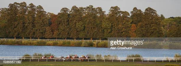 A general view as runners race down the back straight at Kempton Park Racecourse on September 18 2018 in Sunbury United Kingdom
