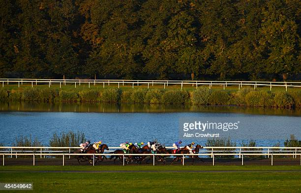 A general view as runners race down the back straight at Kempton Park racecourse on September 03 2014 in Sunbury England