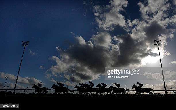 A general view as runners race down the back straight at Kempton Park racecourse on August 26 2015 in Sunbury England