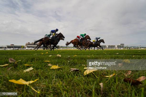 A general view as runners race down the back straight at Newbury Racecourse on August 7 2018 in Newbury United Kingdom
