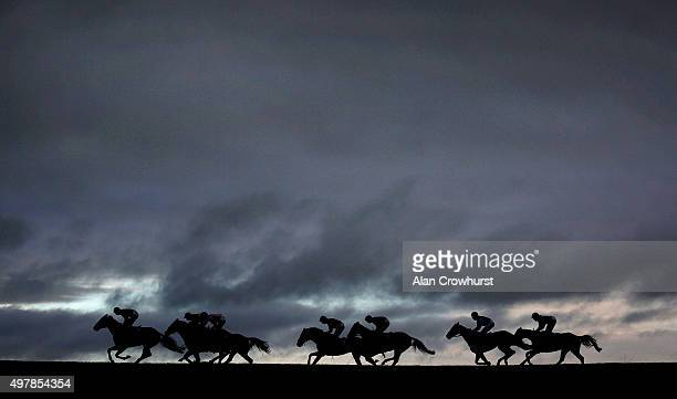 A general view as runners race down the back straight at Wincanton racecourse on November 19 2015 in Wincanton England