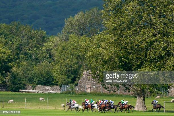 General view as runners race down the back straight in The Mr And Mrs Berbillion Handicap at Chepstow Racecourse on July 17, 2020 in Chepstow, Wales....