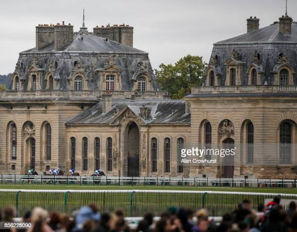 A general view as runners race down the back straight in The Qatar Prix JeanLuc Lagardere during Prix de l'Arc de Triomphe meeting at Chantilly...