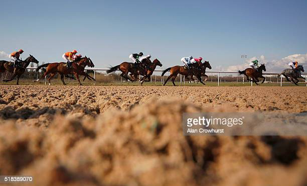 A general view as runners race down the straight at Wolverhampton racecourse on March 31 2016 in Wolverhampton England