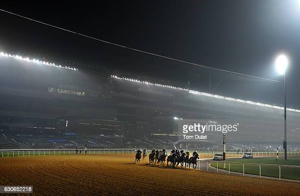 A general view as runners race down the track at Meydan on December 29 2016 in Dubai United Arab Emirates