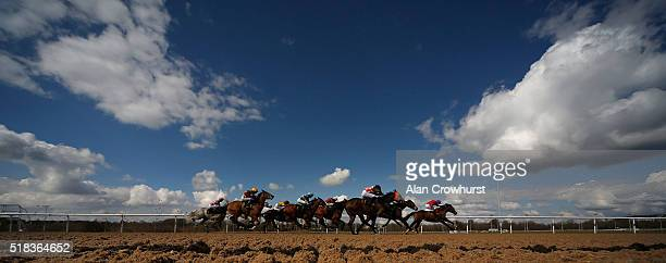 A general view as runners race towards the finish at Wolverhampton racecourse on March 31 2016 in Wolverhampton England