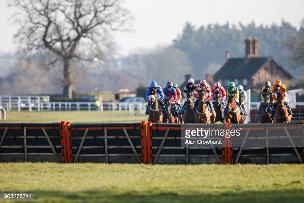 A general view as runners race towards the hurdle in front of the grandstands at Ludlow racecourse on January 10 2018 in Ludlow England
