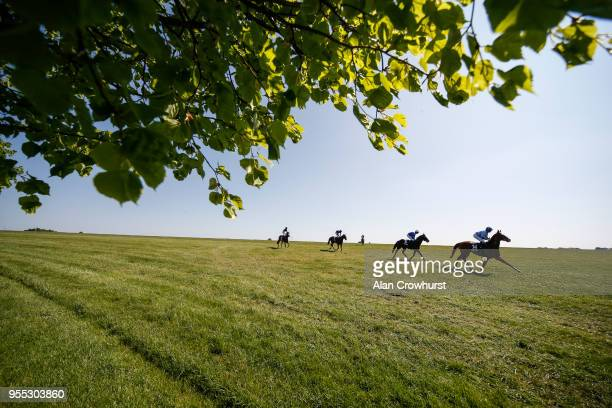 A general view as runners return after finishing at Newmarket Racecourse on May 6 2018 in Newmarket United Kingdom