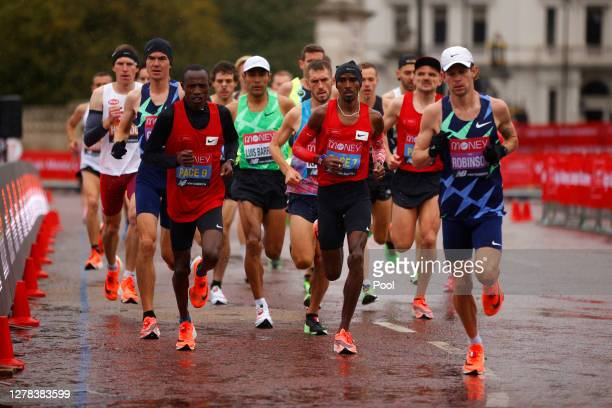 General view as runners run past Buckingham Palace as they compete in the Elite Men's race during the 2020 Virgin Money London Marathon around St....