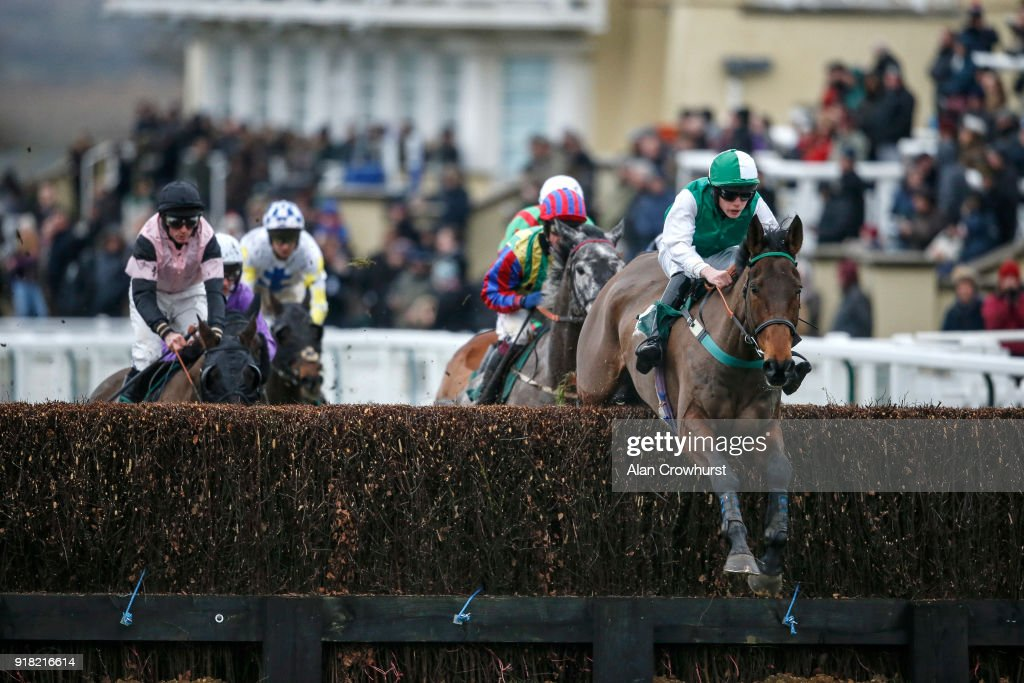 A general view as runners take the fence by the grandstands at Towcester racecourse on February 14, 2018 in Towcester, England.