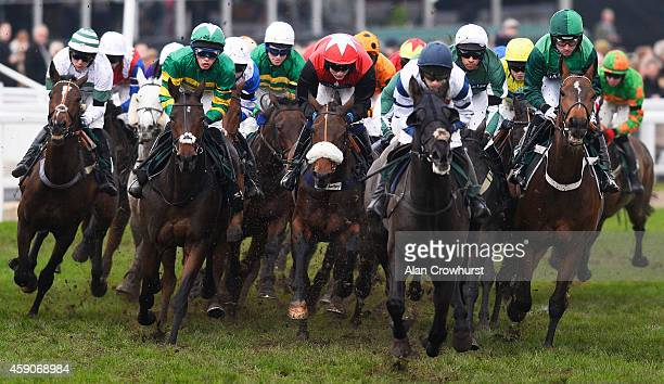 A general view as runners turn into the back straight at Cheltenham racecourse on November 16 2014 in Cheltenham England