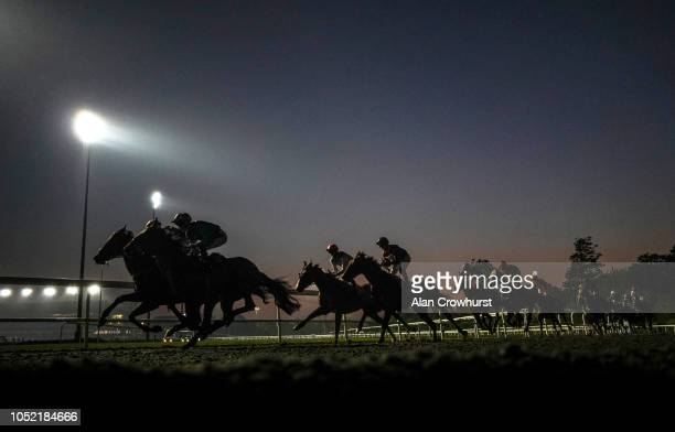 A general view as runners turn into the back straight at Kempton Park Racecourse on October 10 2018 in Sunbury United Kingdom