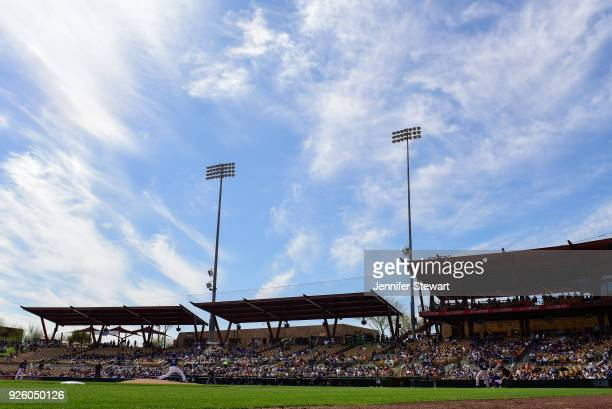 A general view as Scott Alexander of the Los Angeles Dodgers delivers a pitch against the Cleveland Indians in the spring training game at Camelback...