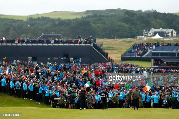 A general view as Shane Lowry of Ireland walks onto the 18th green during the final round of the 148th Open Championship held on the Dunluce Links at...