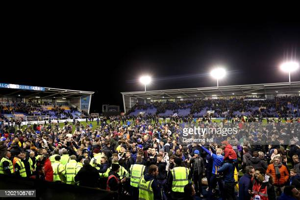 A general view as Shrewsbury fans invade the pitch during the FA Cup Fourth Round match between Shrewsbury Town and Liverpool at New Meadow on...
