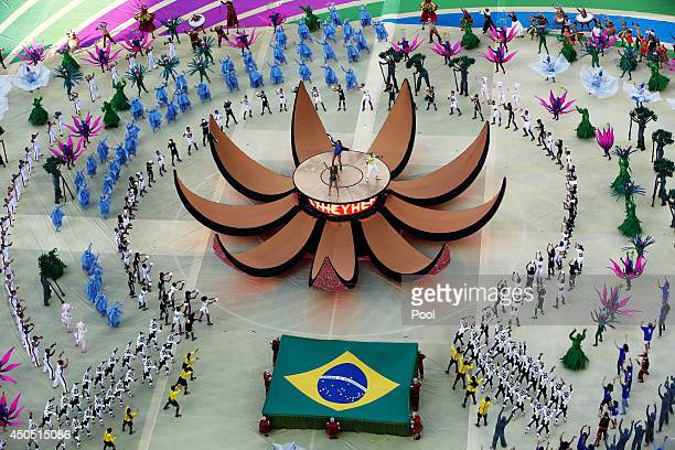 A general view as singers Jennifer Lopez Claudia Leitte and Pitbull perform during the Opening Ceremony of the 2014 FIFA World Cup Brazil prior to...