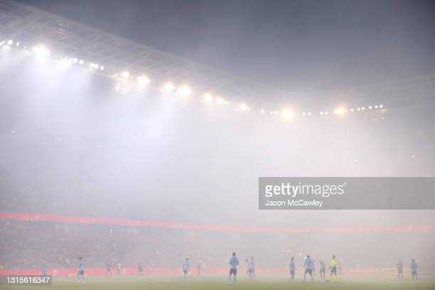 General view as smoke engulfs the pitch during the A-League match between Western Sydney Wanderers and Sydney FC at Bankwest Stadium, on May 01, 2021...