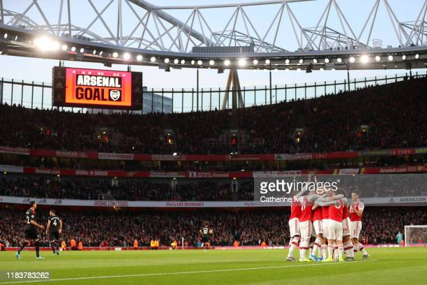 General view as Sokratis Papastathopoulos of Arsenal celebrates with team mates after scoring their team's first goal during the Premier League match...
