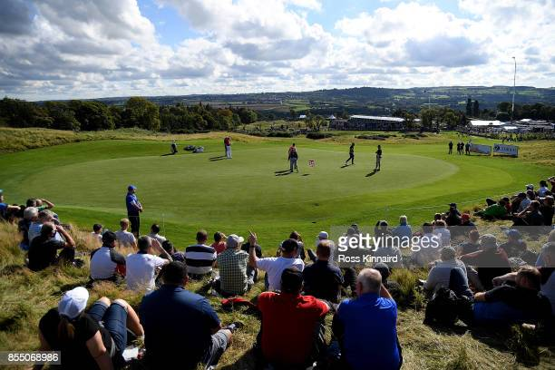 A general view as spectators watch the action on the 1st green during day one of the British Masters at Close House Golf Club on September 28 2017 in...
