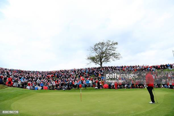 A general view as spectators wear Thomas Bjorn masks to celebrate his 500th European Tour appearance during day one of Made in Denmark at Himmerland...