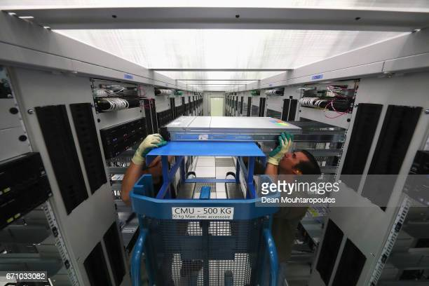 A general view as staff work in the CERN Computer / Data Centre and server farm of the 1450 m2 main room during a behind the scenes tour at CERN the...