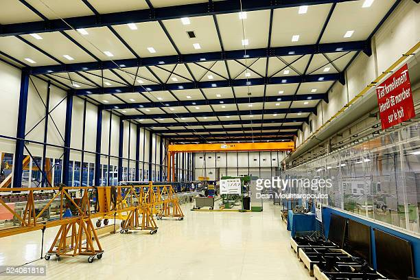 A general view as staff work in the Large Magnet Facility or LMF in Building 180 at The European Organization for Nuclear Research commonly know as...