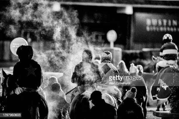 General view as steam rises from runners as they return from racing in The Matchbook Best Odds Handicap Chase at Ascot Racecourse on January 23, 2021...