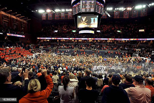 A general view as students and fans of the Virginia Cavaliers celebrate on the court following their game against the Duke Blue Devils at John Paul...