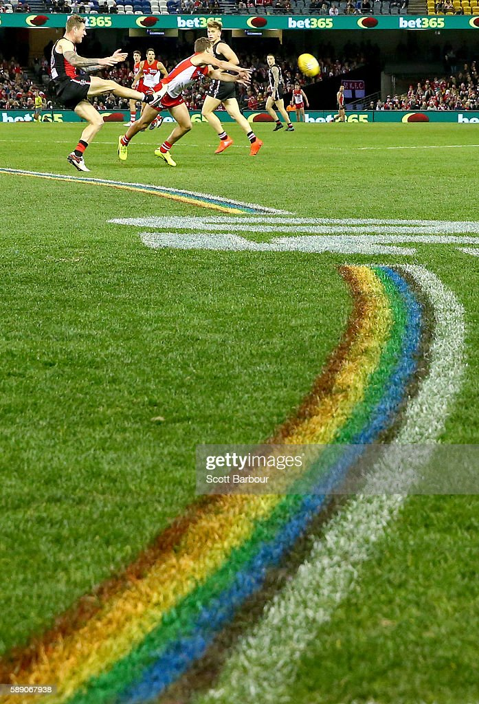 A general view as the 50 metre arcs are painted rainbow-coloured during the round 21 AFL match between the St Kilda Saints and the Sydney Swans at Etihad Stadium on August 13, 2016 in Melbourne, Australia. St Kilda and the Sydney Swans played in the inaugural AFL Pride Game, believed to be a world-first in professional sport - celebrating diversity and inclusion of all people in sport.