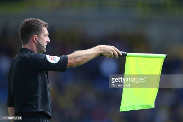 General view as the assistant referee holds up his flag during the Sky Bet League One match between Oxford United and Coventry City at Kassam Stadium...