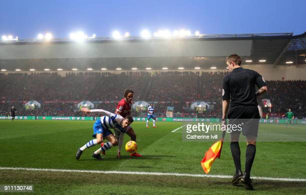 General view as the assistant referee watches Jack Robinson of Queens Park Rangers battle with Bobby Reid of Bristol City during the Sky Bet...