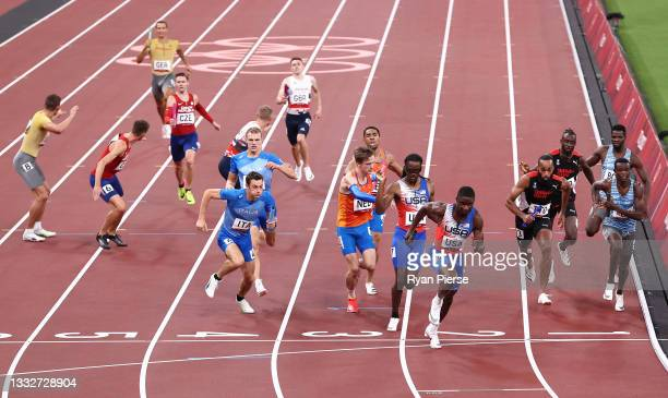 General view as the athletes prepare for a Baton exchange during the Men's 4 x 400m Relay heats on day fourteen of the Tokyo 2020 Olympic Games at...