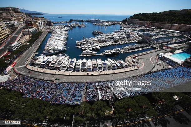 General view as the cars round the harbour and swimming pool complex during practice for the Monaco Formula One Grand Prix at the Circuit de Monaco...