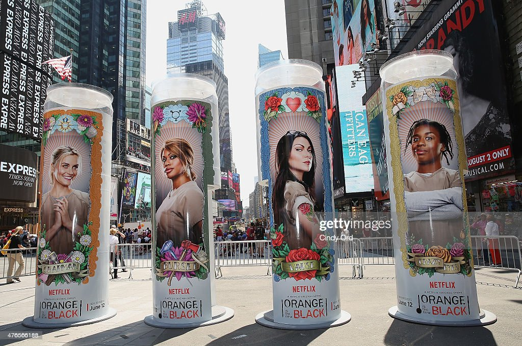 A general view as the cast of the hit Netflix original series 'ORANGE IS THE NEW BLACK' are featured on giant 14 foot tall candle-shaped photo booths in New York's Times Square on June 10, 2015 in New York City. The interactive photo booths project users' photos on to enormous displays in Times Square. 'ORANGE IS THE NEW BLACK' Season 3 premieres on Friday, June 12.