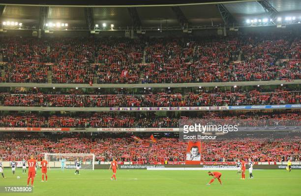 A general view as the crowd of 95446 sing You'll Never Walk Alone during the match between the Melbourne Victory and Liverpool at the Melbourne...