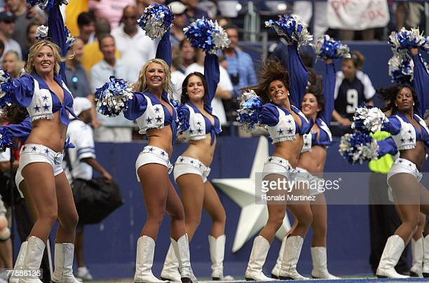 A general view as the Dallas Cowboys cheerleaders perform on the sidelines during the game against the New England Patriots at Texas Stadium on...