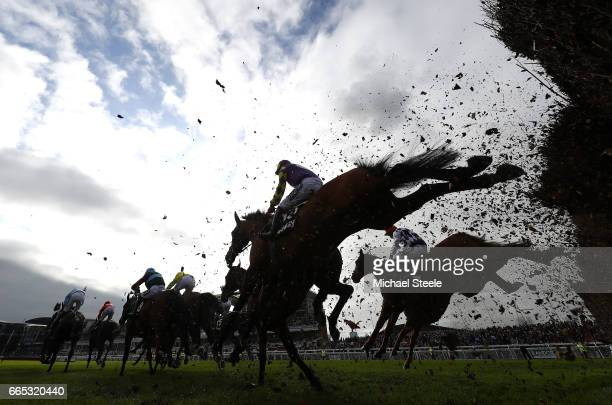 A general view as the field goes over the hurdle in the Betway Red Rum Handicap Race during the Randox Health Grand National Festival at Aintree...