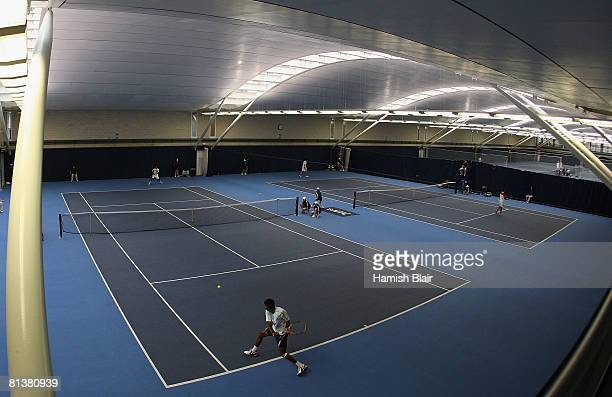 General view as the final rounds of qualifying are played indoors at the National Tennis Centre after bad weather prevented play at Surbiton during...