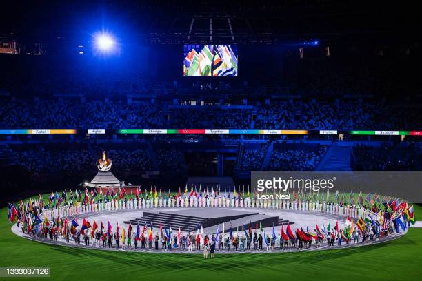 General view as the flag bearers of the competing nations enter the stadium during the Closing Ceremony of the Tokyo 2020 Olympic Games at Olympic...