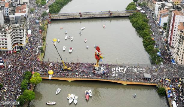 General view as the Galo da Madrugada street carnival band parades with frevo music as background on February 18 2012 in Recife northeastern Brazil...